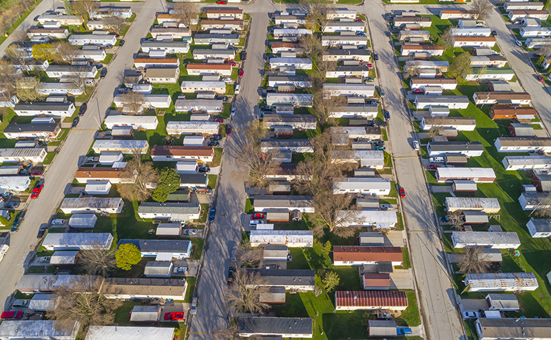 Aerial view looking down on vast trailer park, mobile homes